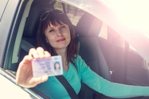 Woman shows a driver's license
